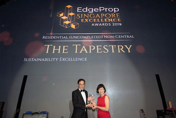 City Developments Ltd's Alfred Ng, assistant vice president, projects, receiving the award for The Tapestry, which won the Sustainability Excellence and Top Development awards (Photo: Albert Chua/EdgeProp Singapore)