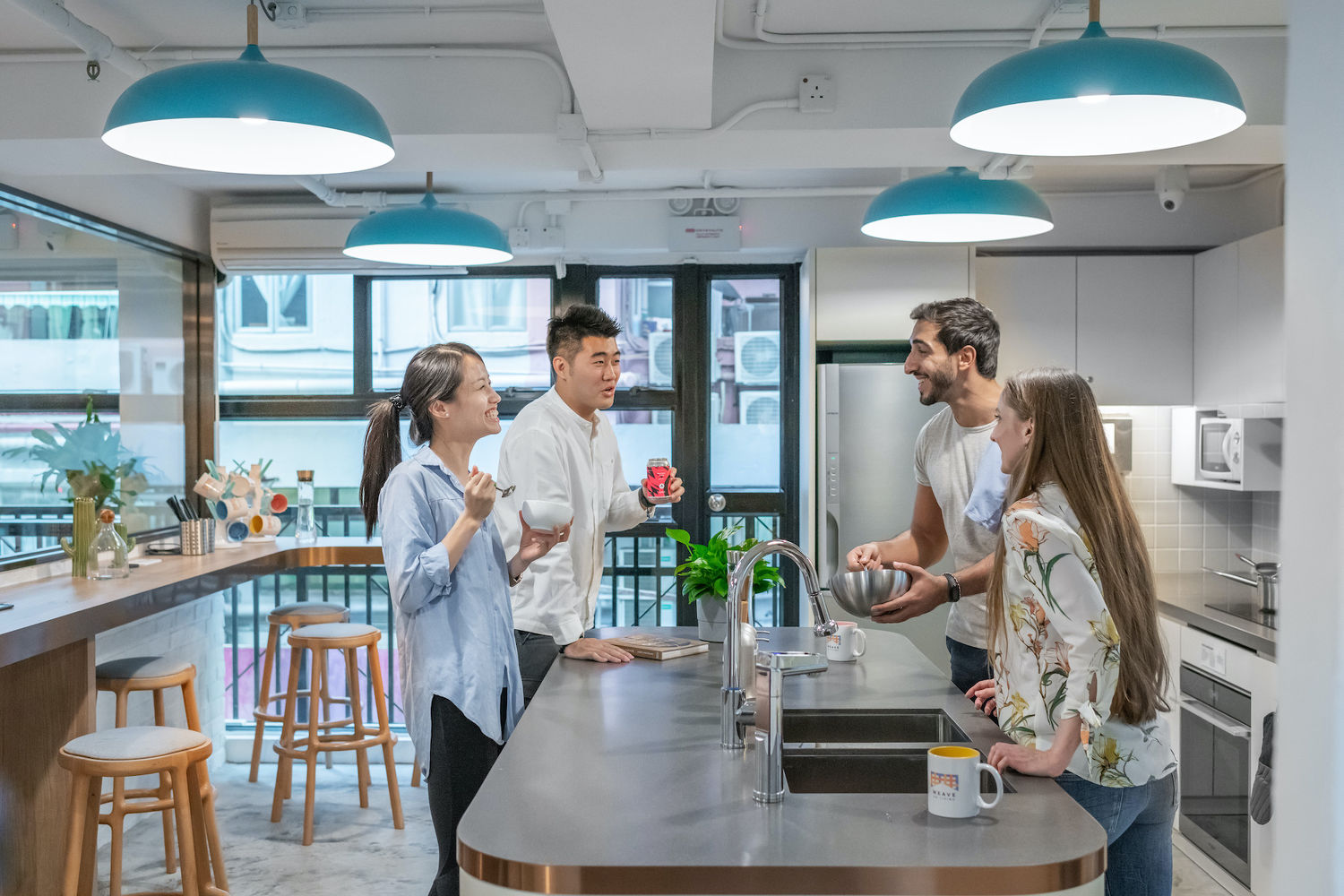 EDGEPROP SINGAPORE -  The kitchen and dining area is one of the shared amenities among residents at Weave on Baker (Photo: Weave Co-Living)