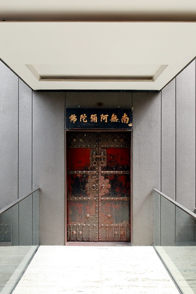The doors to his gallery block are marked by an antique door salvaged from an old building (Photo: Samuel Isaac Chua/EdgeProp Singapore)
