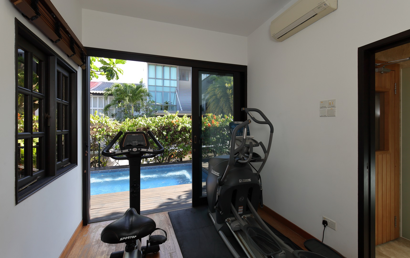 The gym opens out to the jacuzzi pool (Photo: Samuel Isaac Chua/EdgeProp Singapore) - EDGEPROP SINGAPORE