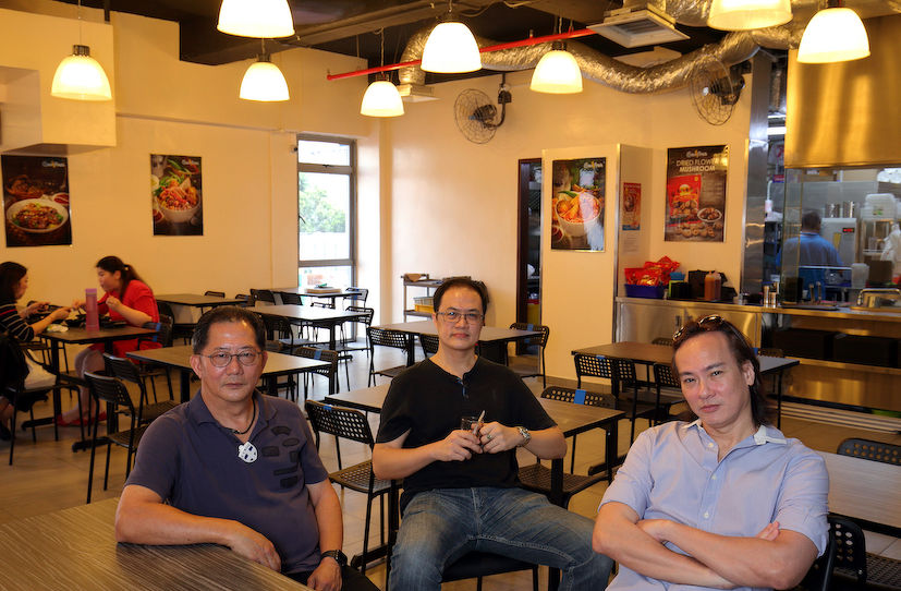 From left: George Tan, proprietor of Gem Fresh Yong Tau Foo at his Bugis Cube outlet, together with Victor Ng, MCST vice chairman of Bugis Cube Victor Ng; and Henry Mok, MCST chairman of Bugis Cube (Photo: Samuel Isaac Chua/EdgeProp Singapore)