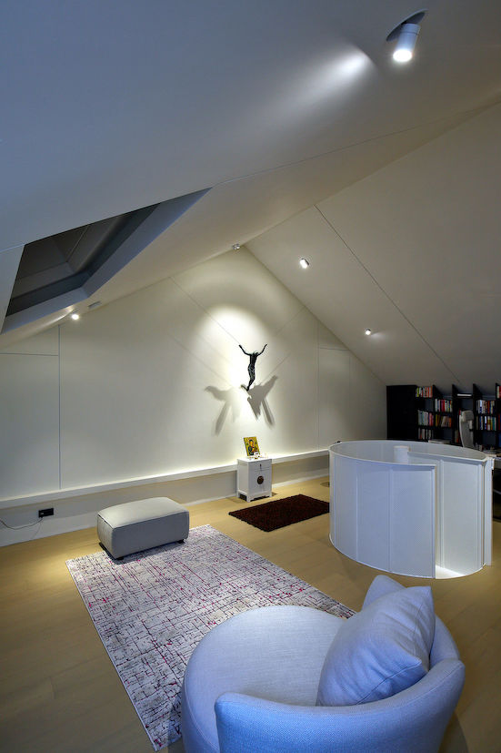 Part of the attic has been turned into a prayer area and features a bronze Corpus Christi crucifix by Indonesian painter and sculptor Teguh Ostenrik (Photo: Samuel Isaac Chua/EdgeProp Singapore)