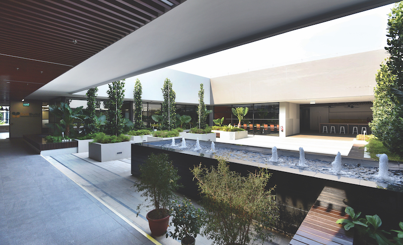 SOILBUILD - Meeting rooms and an open office pantry overlook a central landscaped courtyard at the Soilbuild headquarters in Defu South Street 1 (Credit: Albert Chua/EdgeProp Singapore)