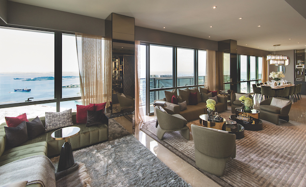 The living room of the penthouse on the 60th floor has an uninterrupted a view of the sea, Sentosa Cove and the future Greater Southern Waterfront (Photo: Albert Chua/EdgeProp Singapore) - EDGEPROP SINGAPORE