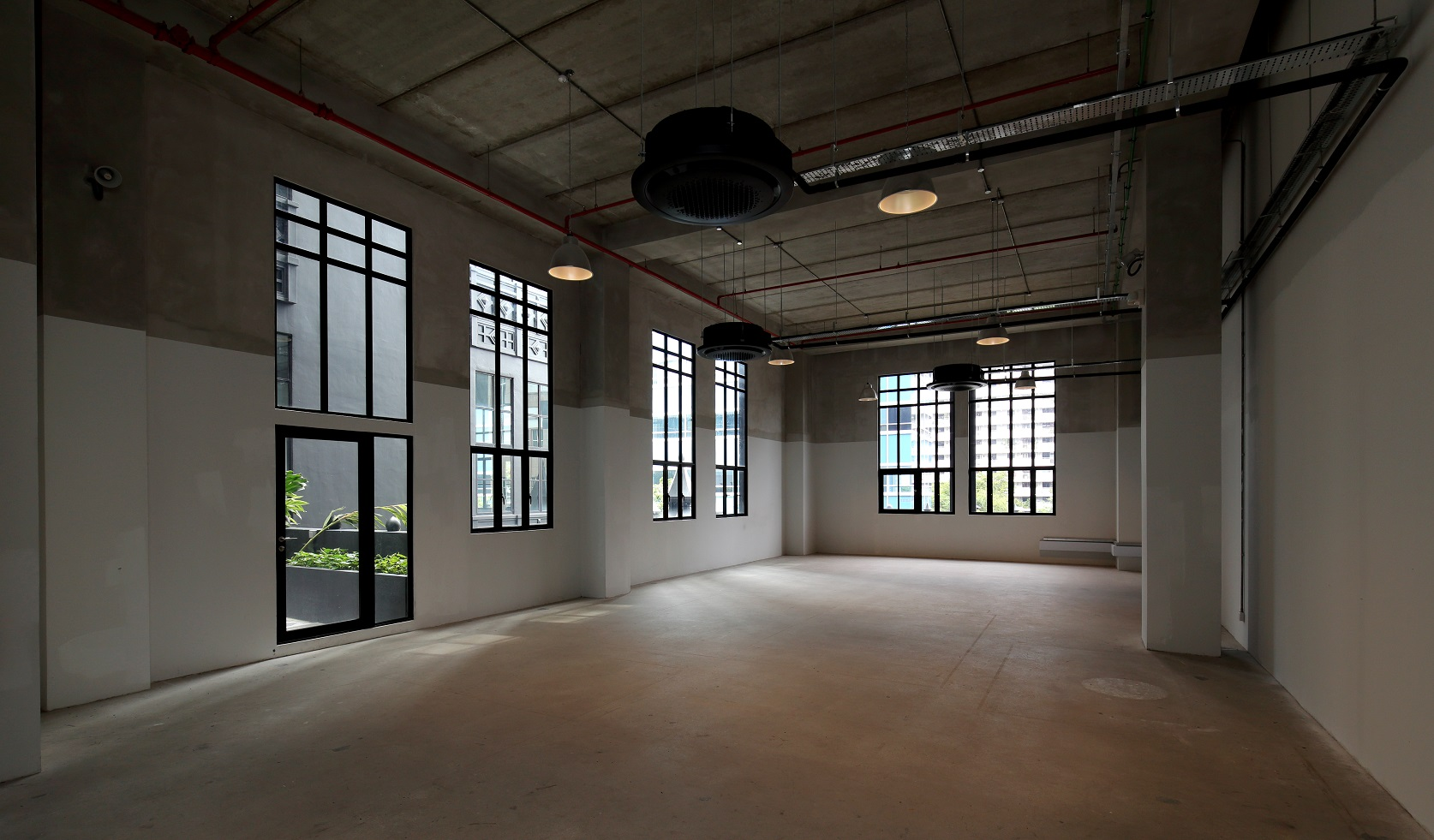 A typical office unit at The Mill has 6m ceiling height and 2.4m tall windows. The units on the second level have approval for F&B use (Photo: Samuel Isaac Chua/EdgeProp Singapore)