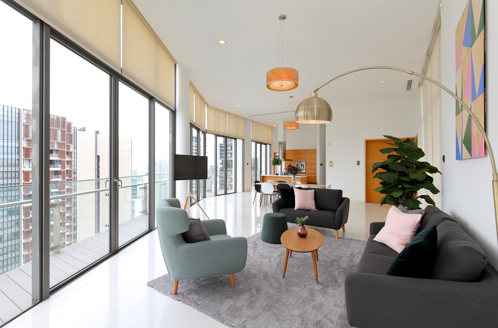THE LUMOS - The living room of the four-bedroom, duplex penthouse at The Lumos which was recently furnished by Login Apartment as a co-living unit (Photo: Samuel Isaac Chua/EdgeProp Singapore)