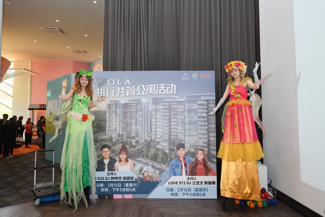 Stiltwalkers (pictured), jugglers and live entertainment shows were part of the carnival-like atmosphere at the public preview of OLA last weekend (Photo: Evia Real Estate) - EDGEPROP SINGAPORE