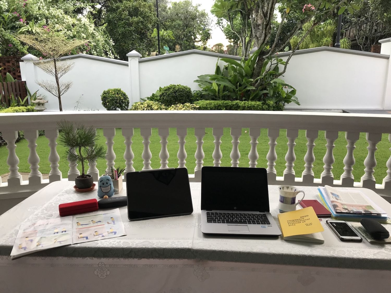 Ong turned two barbeque tables into her workstation at home, so she can have a view of her garden while she's working (Photo: Ong Choon Fah/Edmund Tie)