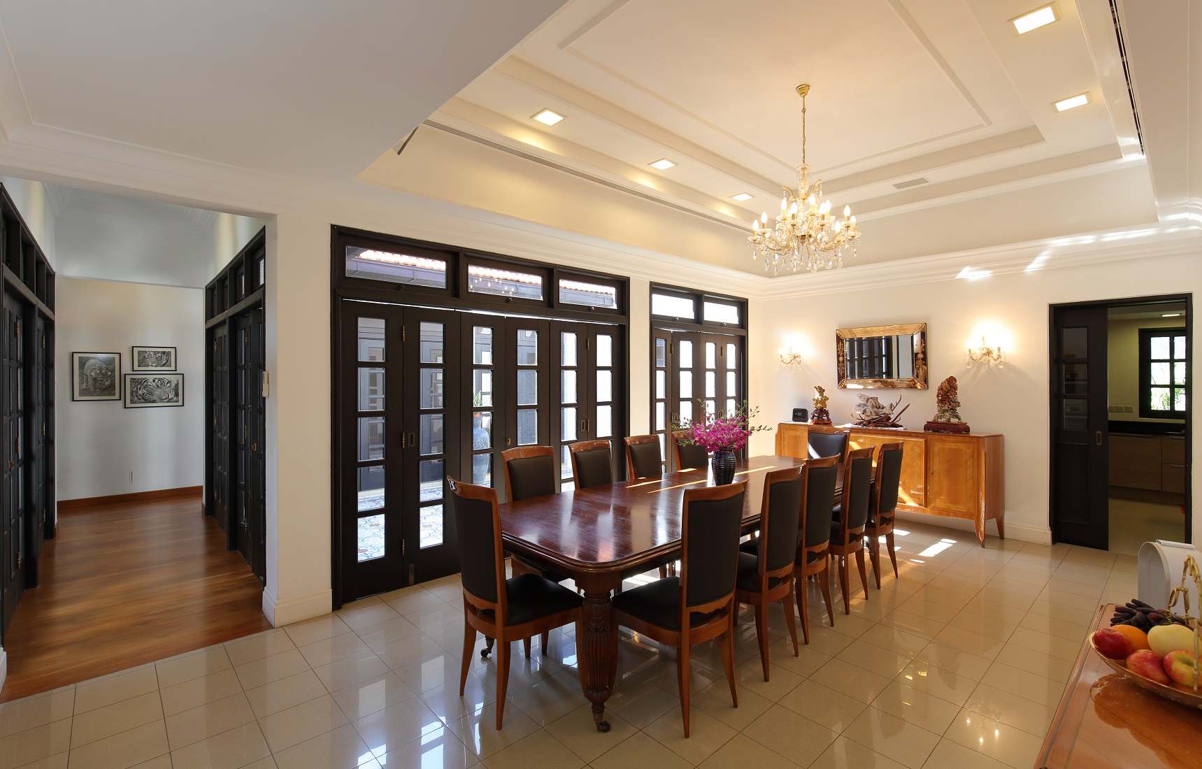 The dining room with French doors leading out to the tiled courtyard (Photo: Samuel Isaac Chua/EdgeProp Singapore)
