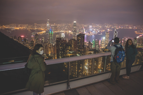 Increasingly, despite more stringent travel restrictions, the impact of Covid-19 has broadened to other parts of the world through secondary outbreaks.(Photo: Bloomberg) - EDGEPROP SINGAPORE