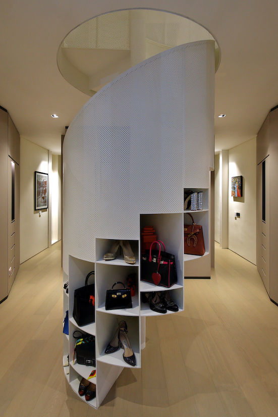 The spiral staircase in the wardrobe area has niches which allows Kan's wife, Mei Ling to display her handbags and shoes (Photo: Samuel Isaac Chua/EdgeProp Singapore)