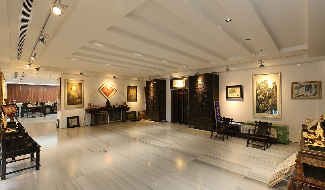 Part of his collection of artwork on the second level of his gallery (Photo: Samuel Isaac Chua/EdgeProp Singapore)