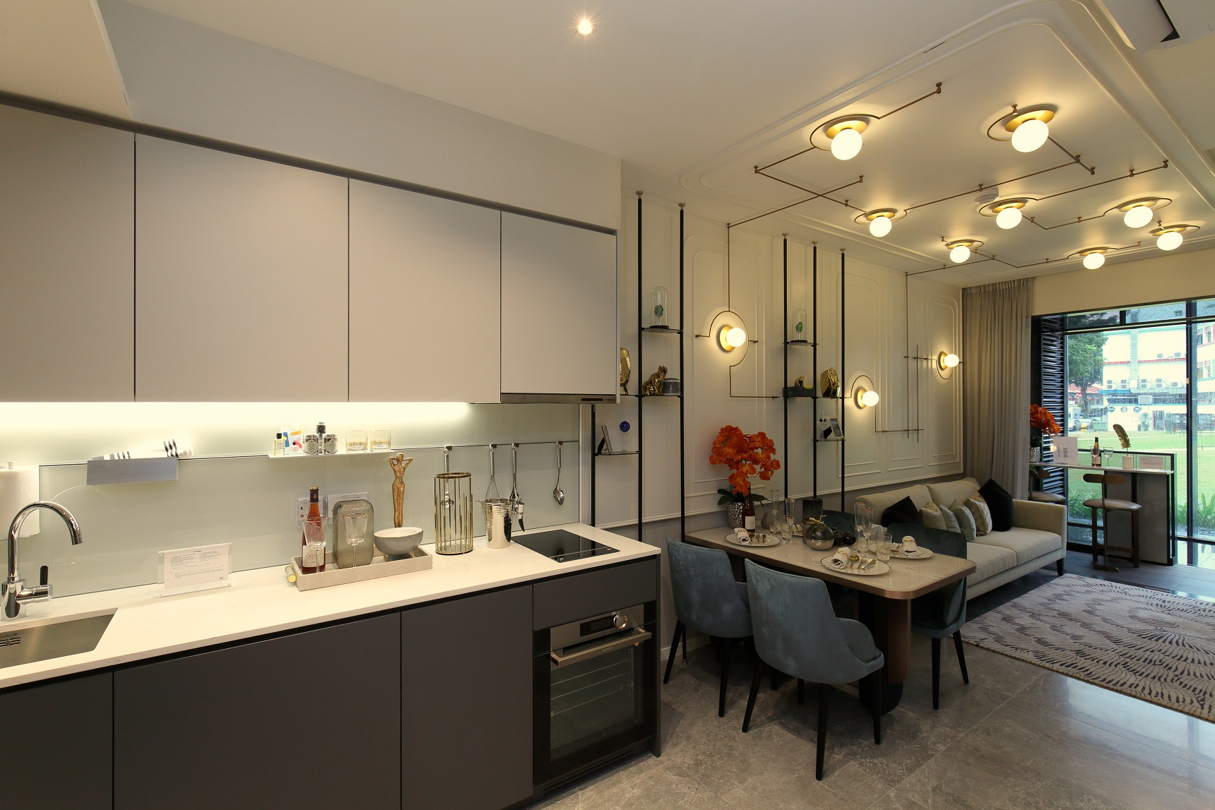 The open kitchen of the two-bedroom-plus-study is fitted with a hanging rack in addition to storage cabinets (Photo: Samuel Isaac Chua/EdgeProp Singapore) - EDGEPROP SINGAPORE
