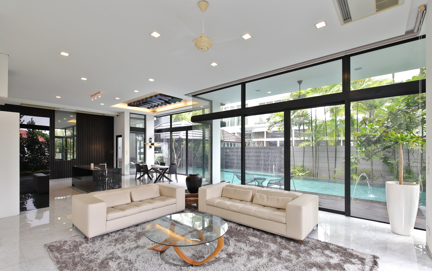 The first level of the house is where the living and dining area, a second open kitchen and an infinity swimming pool are situated (Photo: Samuel Isaac Chua/EdgeProp Singapore)