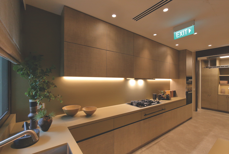 The fully-equipped enclosed kitchen and utlity area (Credit: Samuel Isaac Chua/EdgeProp Singapore)