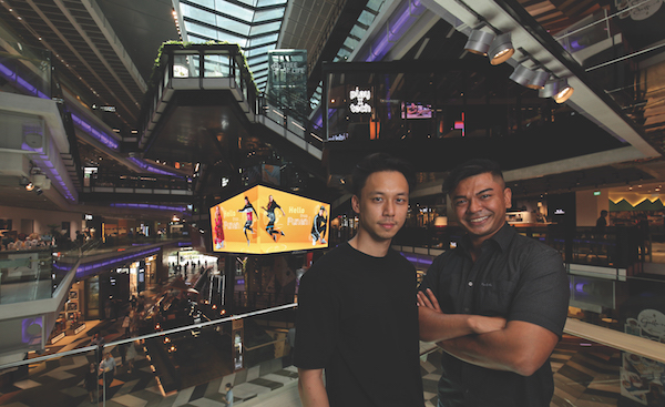 RSP's Loh Zhu Ping and Shaziran Shahabdeen, in front of the Tree of Life (Credit: Samuel Isaac Chua/ The Edge Singapore)