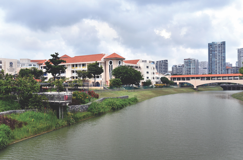 POTONG PASIR - The Kallang River runs through Saint Andrew's Village, with the Junior College (pictured) linked to the Junior School and Secondary School via a bridge