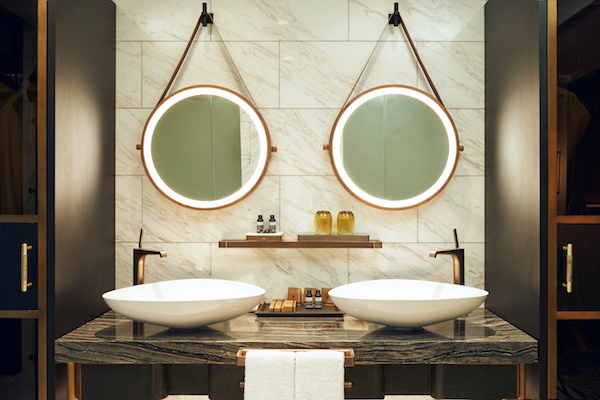 The shell-shaped basin in white porcelain by Hansgrohe gives a timeless yet modern look (Credit: Far East Hospitality) - EDGEPROP SINGAPORE