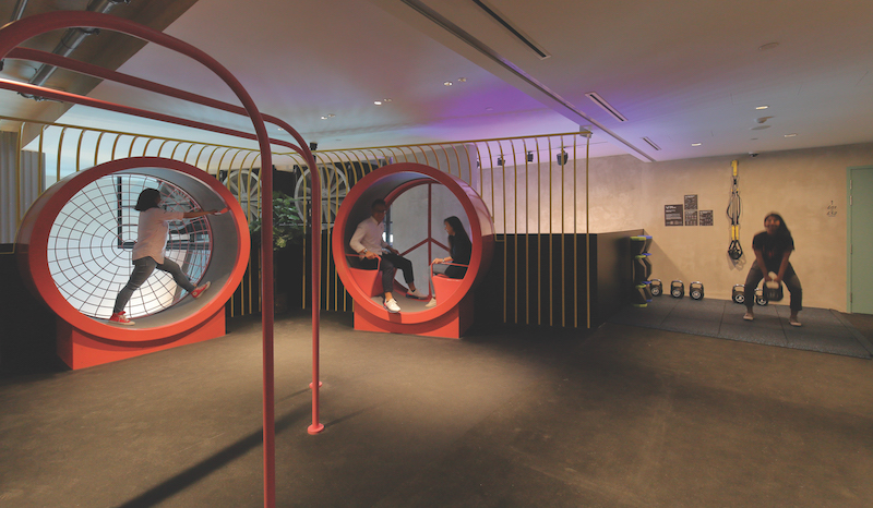 Adding on to the fun element, the gym on the second level not only has weights and TRX gear, but also a treadmill disguised as a life-sized hamster wheel (Credit: Samuel Isaac Chua/ EdgeProp Singapore)