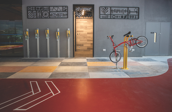 The bicycle hub at Funan houses amenities such as shower cabins, lockers, and a bicycle repair and pump station (Credit: CapitaLand)