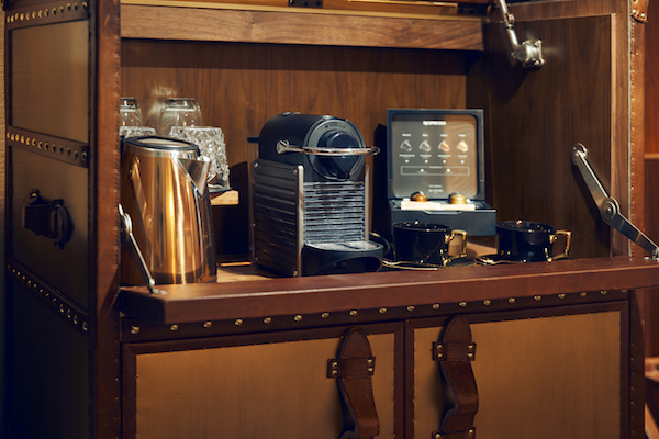 The minibar and the Nespresso machine on a vintage-looking cabinet (Credit: Far East Hospitality) - EDGEPROP SINGAPORE