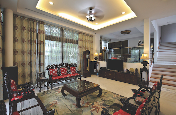 The house is decorated with classical Chinese furniture like these carved throne armchairs in the living room (Credit: Samuel Isaac Chua/ The Edge Singapore)