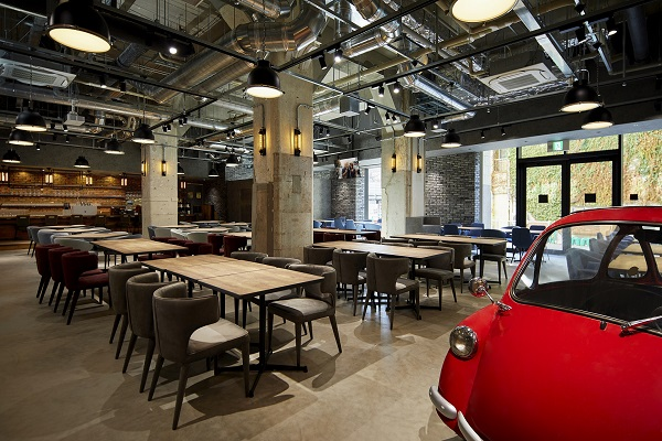 The restaurant at Citadines Namba Osaka gets the industrial look and features a vintage car as a focal point (Credit: Ascott)