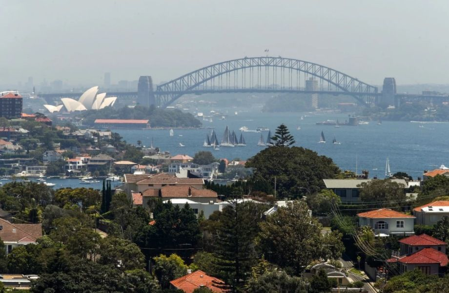 Residential buildings with the famous Sydney Harbour Bridge and opera house in the background. Photo: Bloomberg