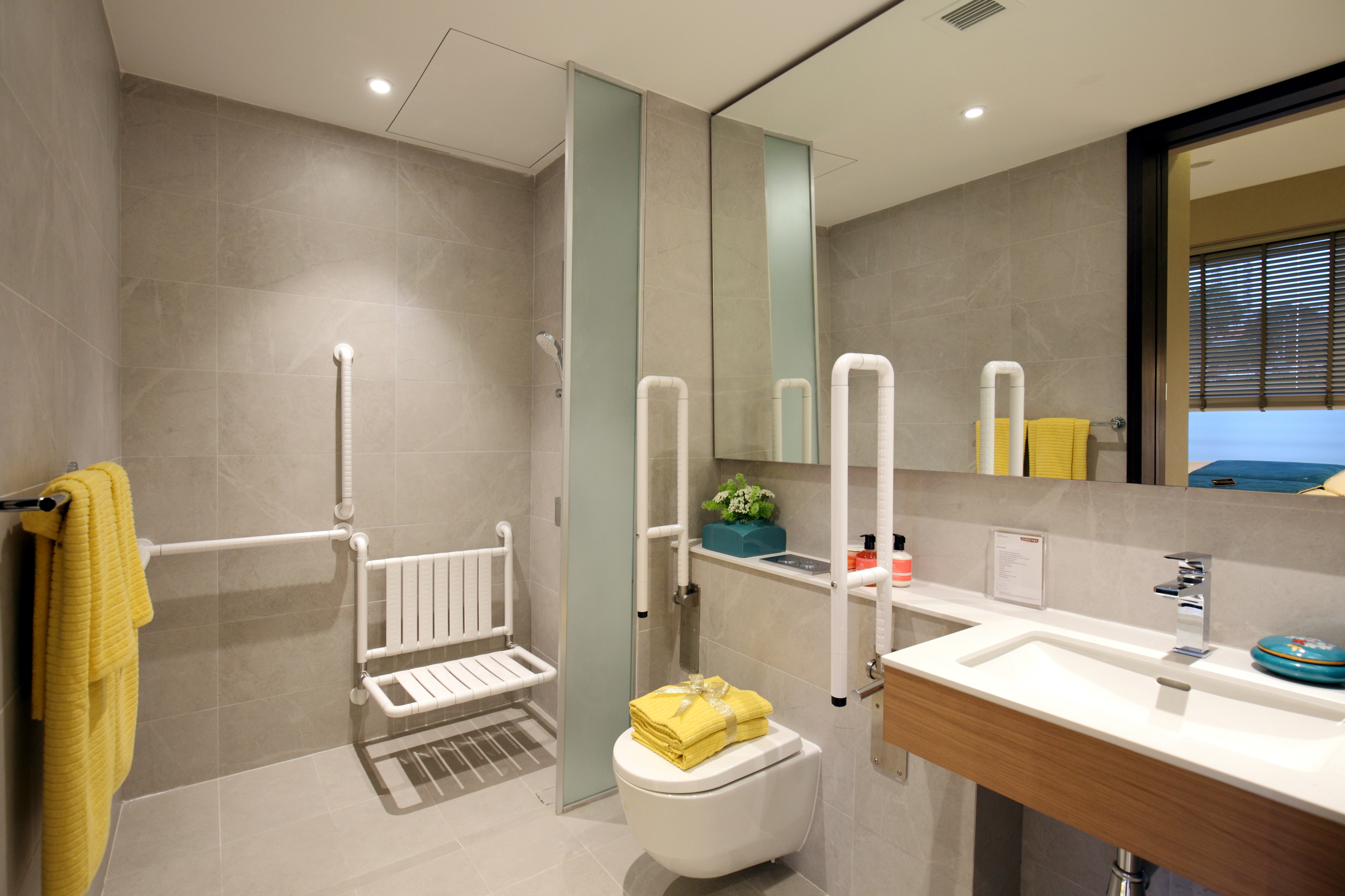 A show suite of a 'Gold Standard' one-bedroom unit and bathroom catering to active senior living - EDGEPROP SINGAPORE
