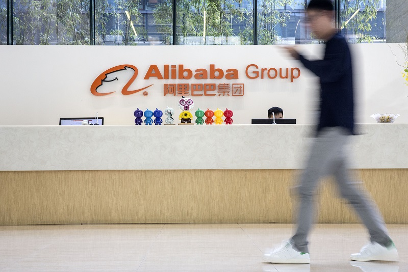 A man walks past a reception desk at the Alibaba Group Holding Ltd. headquarters in Hangzhou, China. (Photographer: Qilai Shen/Bloomberg) - EDGEPROP SINGAPORE