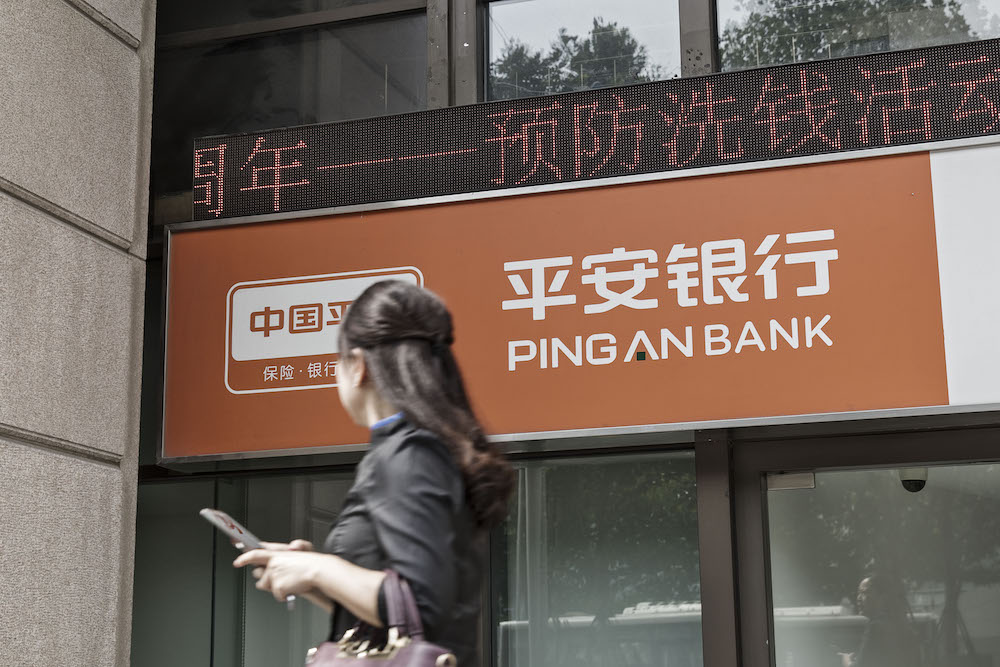 A pedestrian walks past a Ping An Bank Co. branch, a unit of Ping An Insurance Group Co., in Shanghai, China (Photographer: Qilai Shen/Bloomberg) - EDGEPROP SINGAPORE