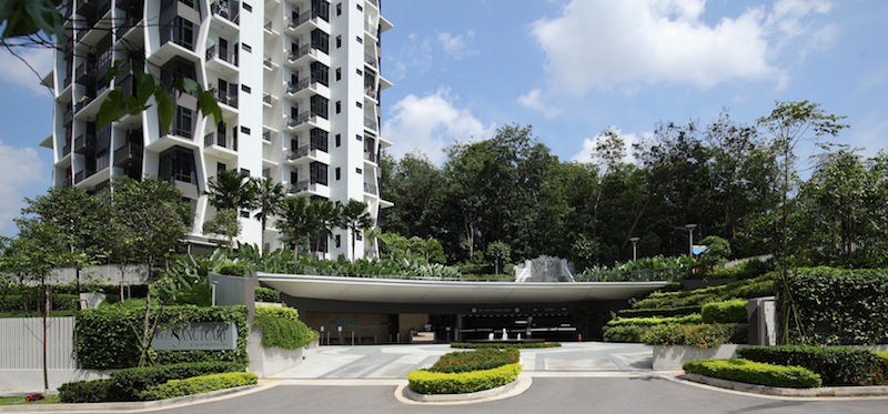 The wide porch at the entrance to Eco Sanctuary, with the lush greenery of Zhenghua Park in the background - EDGEPROP SINGAPORE