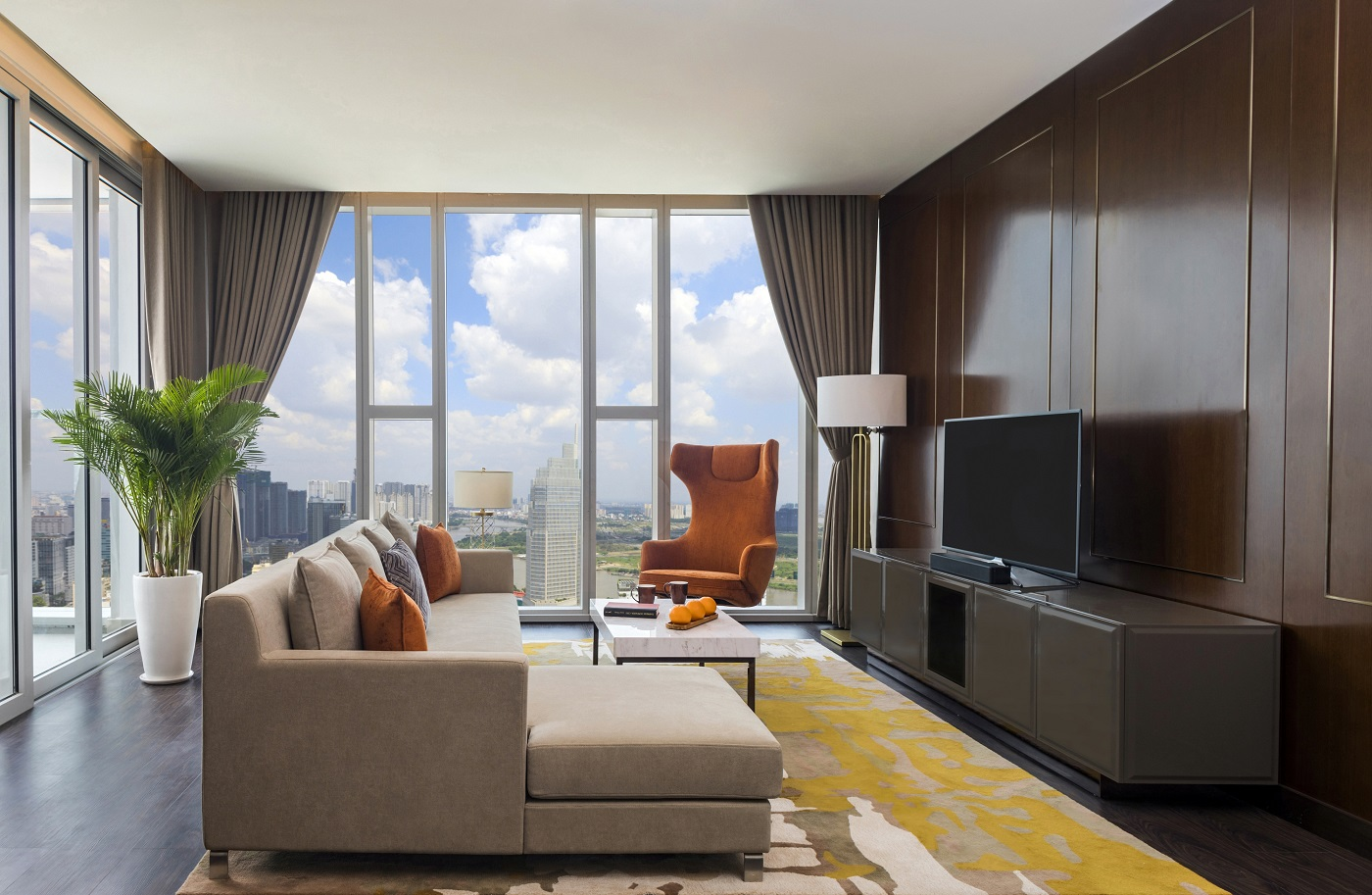 Living room of a Grand Three Bedroom suite at Sedona Suites HCMC