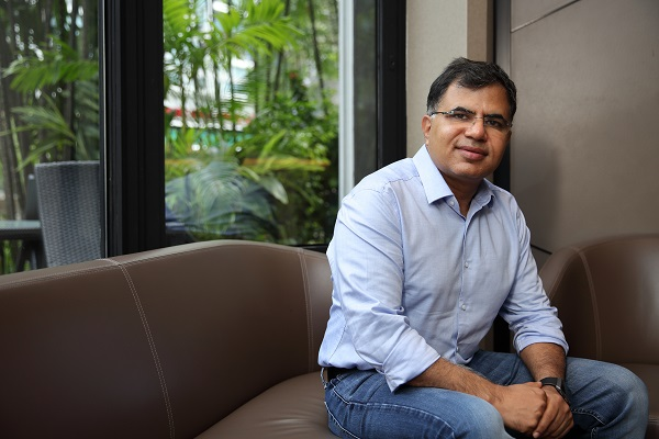 Amit Saberwal, CEO and co-founder of RedDoorz, prefers to keep the company nimble and scalable to technology (Picture: Samuel Isaac Chua/EdgeProp Singapore) - EDGEPROP SINGAPORE