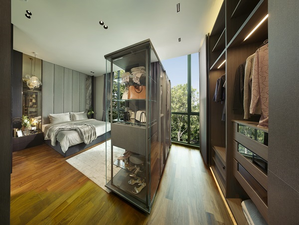 The master bedroom on the second floor with floor to ceiling windows also has space for a walk-in wardrobe.