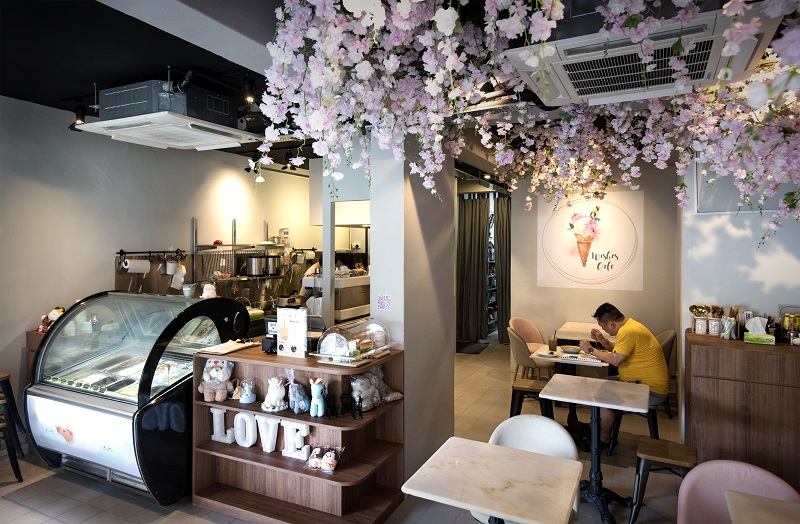 MACPHERSON -  With its sakura-themed interior, Wishes Café stands out among a row of provision shops and clinic