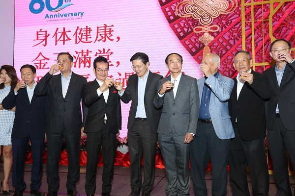 Members of the Redas management committee, including Redas president Chia Ngiang Hong (fourth from left) and Lawrence Wong (fifth from left) Minister for National Development, welcomed the new lunar new year at the Redas Spring Festival lunch on Jan 31. (Picture: Redas)