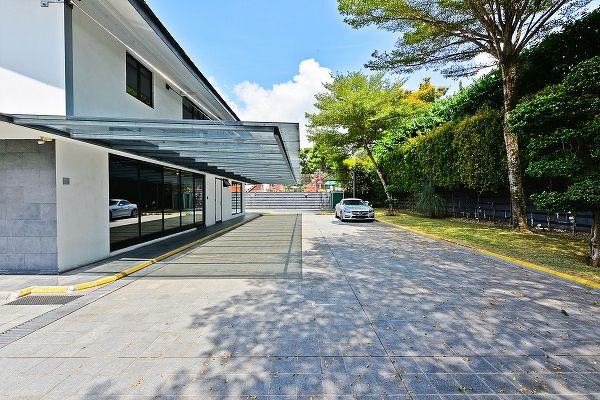 The 9,599 sq ft site has a car porch that has plenty of space to showcase a sizeable car collection