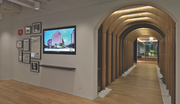 The archway leading to the social space has concealed doors opening to nursing rooms and a prayer room.