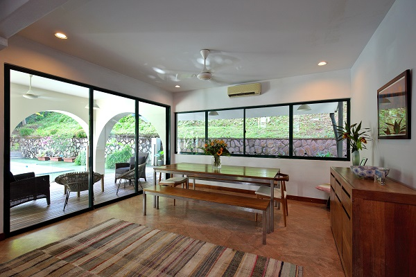The dining room leads to an outdoor lounge area, which is a favourite spot where the owner's wife used to relax.