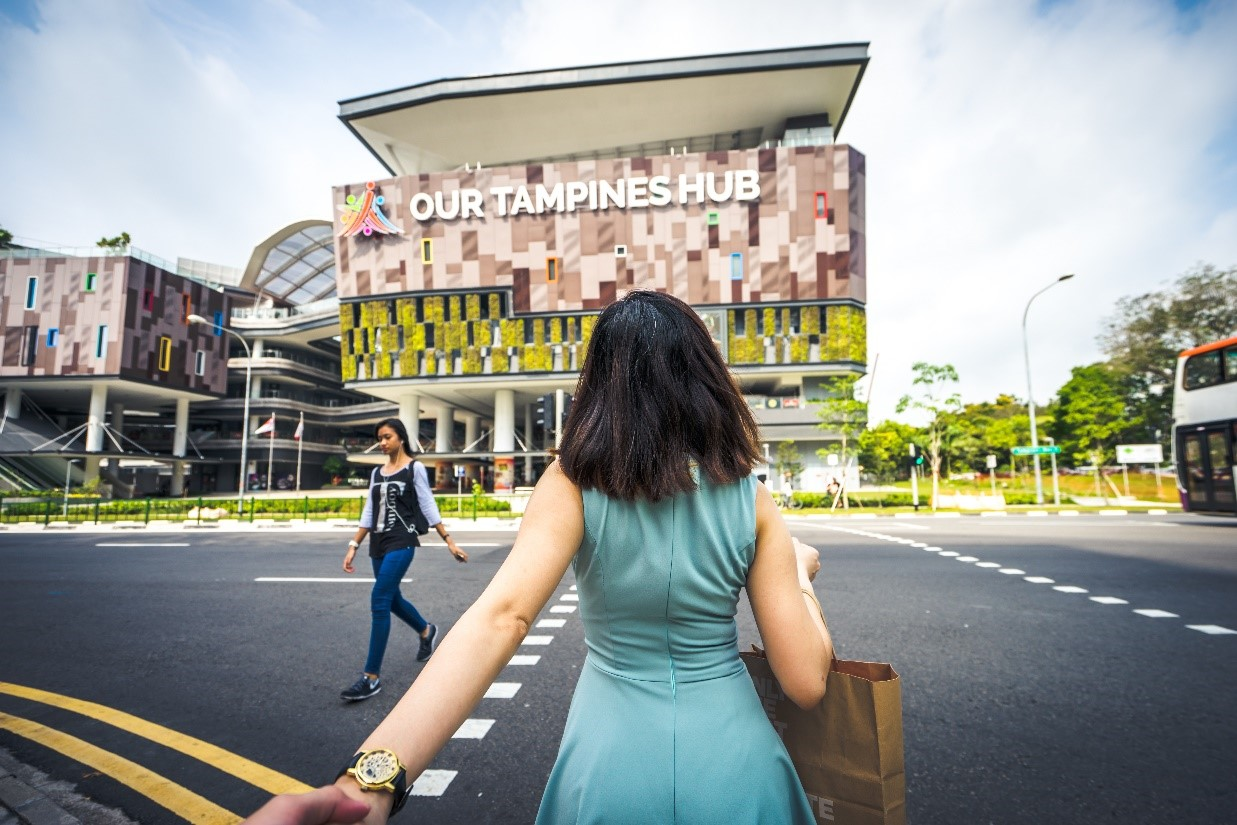 Photo of girl standing in front of Our Tampines Hub