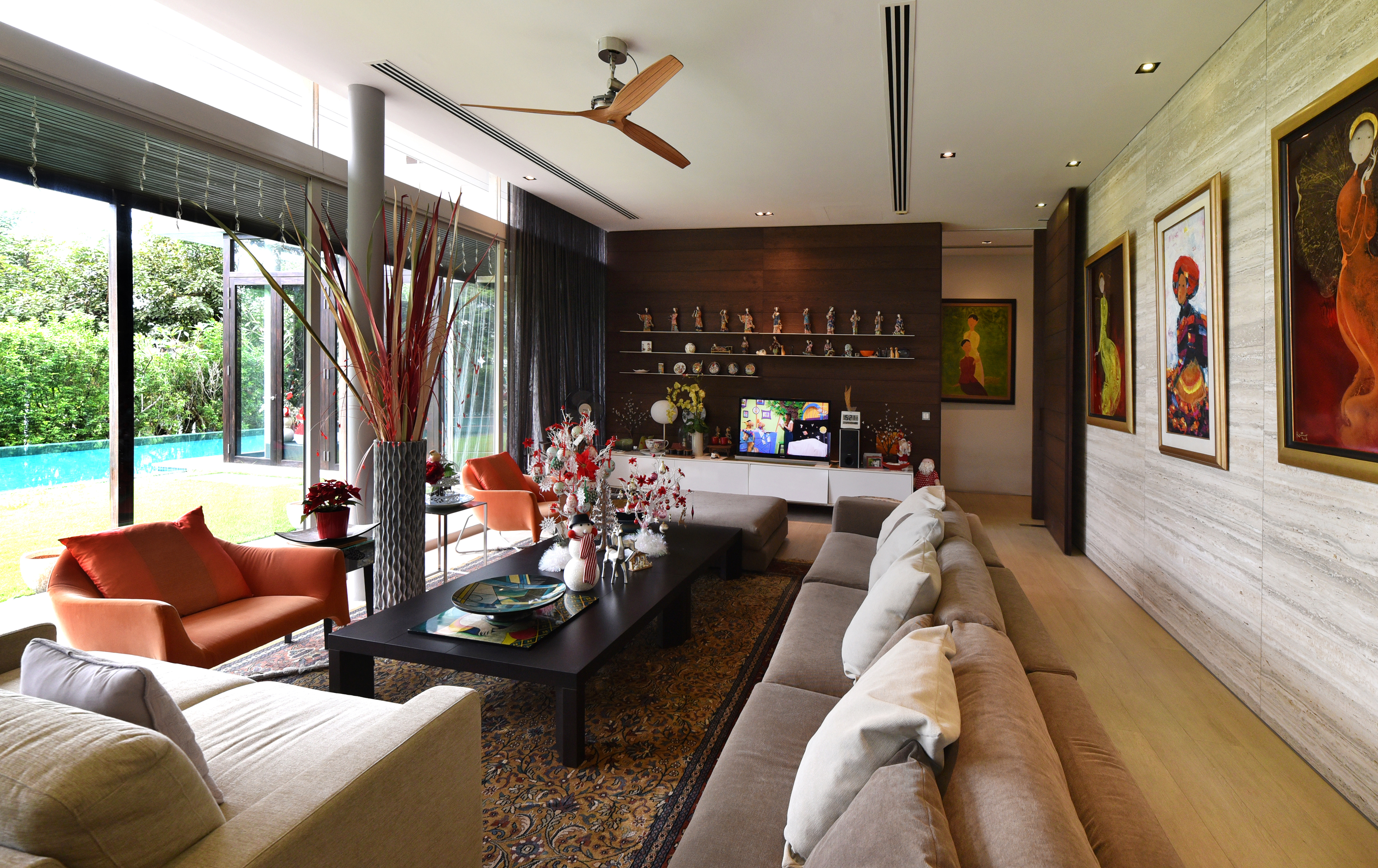 Interior Designer: Poetus  The living space on the ground floor opens out  to the lawn and pool